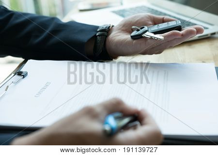 Businessman Present Signing Sales Contract With Car Key To Customer At Office. Ownership, Customer B