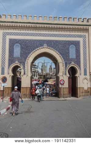 Fez, Morocco - May 9, 2017: Bab Bou Jeloud the Blue Gate the main gated entrance to the old UNESCO protected Medina of Fez El Bali a world heritage site Northern Morocco