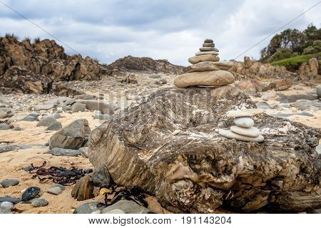 Stone pebble cairn in the beach. Zen concept.