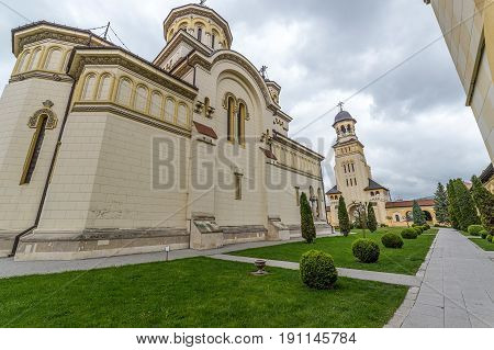 Fish eye view with Coronation (Reunification) Cathedral and Bell tower from Alba Iulia city Transylvania Romania.