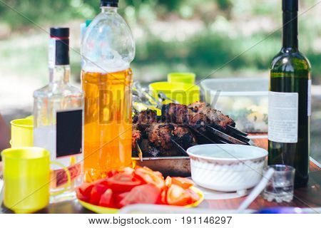 barbecue in the backyard on table with wine beer