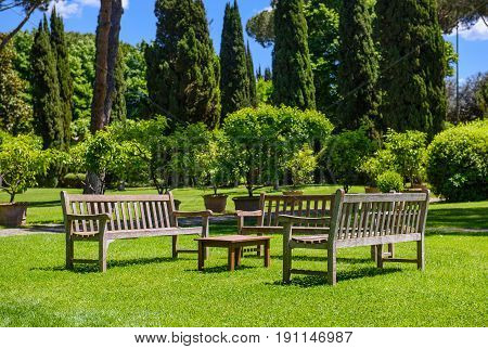 Benches and a table in the garden sunny day