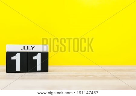 July 11th. Image of july 11, calendar on yellow background. Summer time. With empty space for text.