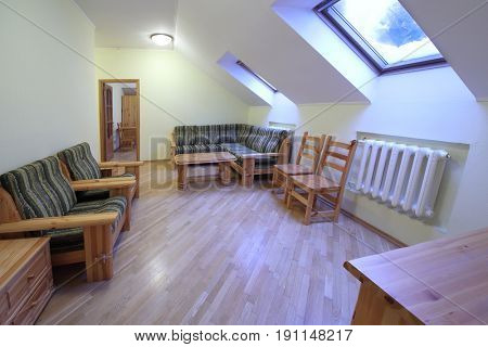 Empty room with sofas and wooden furniture