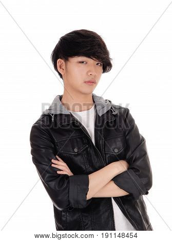 A closeup portrait image of a young Asian man with his arms crossed serious isolated for white background.