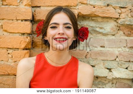Woman With Dental Braces On Teeth