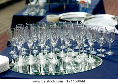 Champagne Glasses On Table At Wedding Reception Outdoors. Empty Glasses For Champagne Drinks On Tray