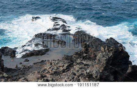 Rugged and beautiful Olivine pools on coastline around north east of Hawaiian island of Maui on Kahekili highway