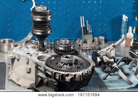 Cross-section of a car gearbox. mechanic work in the garage.