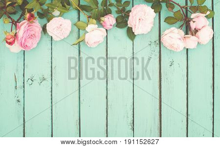Shabby Chic Vintage Background with Roses on wood.