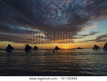 sailing boats at sunset on boracay tropical paradise island philippines