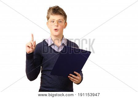Surprised teenager with glasses holds a pen and looks at the folder