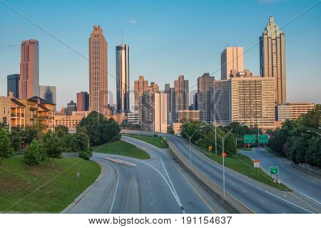 Horizontal photo of the Atlanta skyline as seen in the early morning from the Jackson Street Bridge