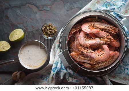 Big shrimps and savory sauce on the background horizontal
