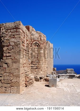 the ruins of an ancient church on the acropolis at lindos in rhodes