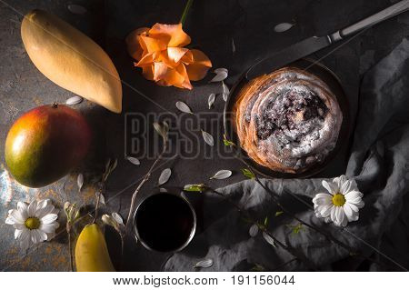 Tea party still ife with fruits and flowers horizontal