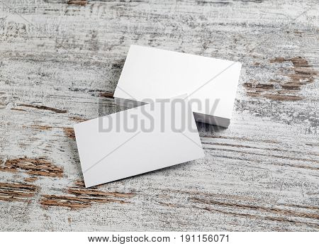 Mockup of blank business cards stacks on wooden table background. Template for your design.