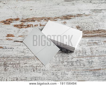 Photo of blank business cards blank business cards on vintage wooden floor background.