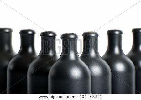 Set Of Empty Black Clay Bottles On A White Background Close-up..