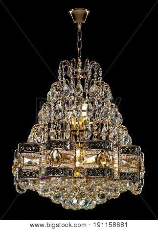 Large crystal chandelier isolated on black background. Luxury royal expensive chandelier for living room, Hall of celebration.