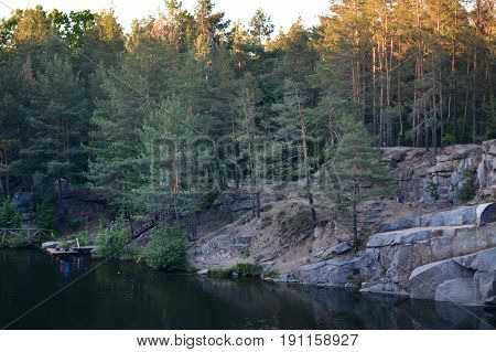 Quarry with water in the forest in details