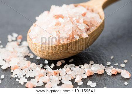 Himalayan Pink Crystal Salt. Spoon Of Pink Himalayan Salt On Slate Plate