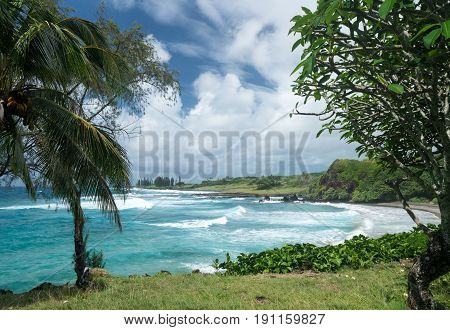 Waves break on Hamoa beach near Hana on Hawaiian island of Maui