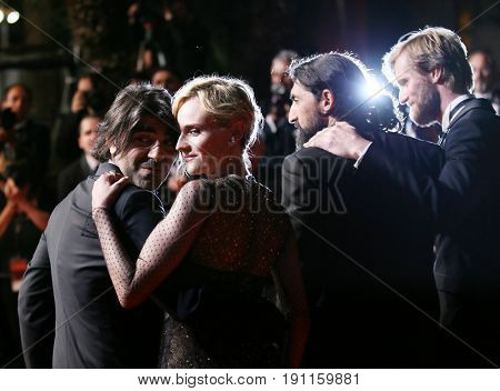 Faith Akin, Diane Kruger, Numan Acar and Ulrich Brandhoff attend the 'In The Fade (Aus Dem Nichts)' premiere during the 70th Cannes Film Festival at Palais on May 26, 2017 in Cannes, France.