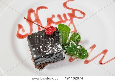 Delicious Dessert. A Piece Of Chocolate Cake With Powder, Cherry And Mint. Horizontal Frame