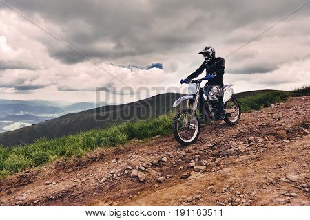 Carpathian mountains in Ukraine.Man rides a motorcycle in the mountains. Mountain range in summer Green mountainmountain peak mountain landscape.