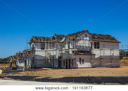 Two Story Home Under Construction With Scaffolding