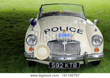 Beaulieu, Hampshire, Uk - May 29 2017: Nice Image Of A Classic Vintage Mga Roadster In Uk Police Liv