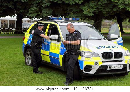 Beaulieu, Hampshire, Uk - May 29 2017: Two British Policemen Taking A Break With Their Bmw Patrol Ca