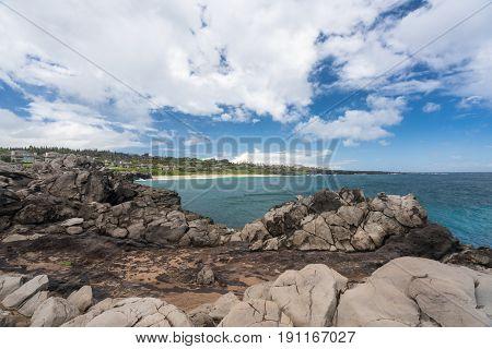 Coastline and housing development on golf course from Makaluapuna Point near Kapalua, Maui, HI, USA