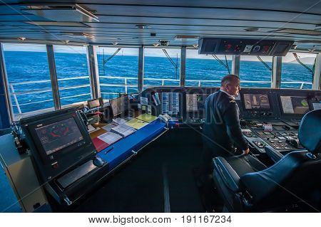 SOUTH ISLAND, NEW ZEALAND- MAY 25, 2017: Ferry boat pilot command cabin with the captain operating the machines with a beautiful view on the sea, in new zealand.