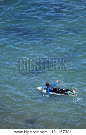 APRIL 23, 2017. SANTA CRUZ, CA. CIRCA:  Surfer enjoying the cool waters in Santa Cruz, Ca.
