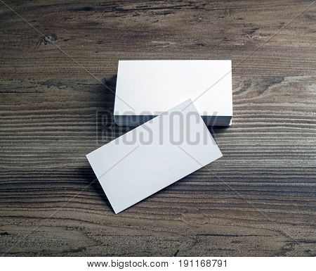 Blank bussiness cards on wood background. Mockup for ID. Template for promotion of corporate identity.
