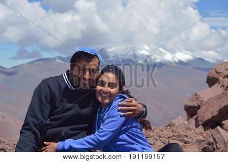Happy couple enjoying pure air in the snowy heights of Acay, Salta, Argentina