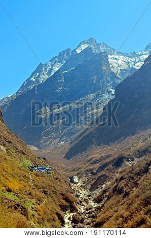 Lodge in Mountain Landscape in Himalaya, Annapurna Base Camp track. Annapurna Nepal.