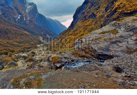 Mountain Landscape in Himalaya, Annapurna Base Camp track, Nepal. Trail and stream.