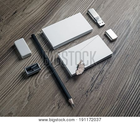 Bank business cards pencil eraser flash drive and sharpener on wood background. Responsive design template with plenty of copy space for placing your design. Mockup for ID.