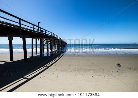 Image of a wharf jutting out into the sea