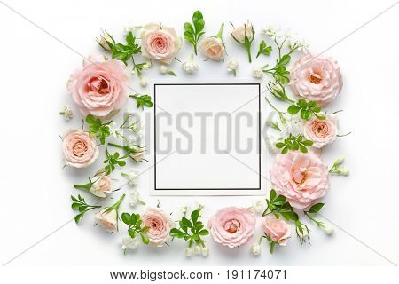 pink roses and blank card on white background
