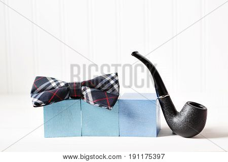 Wooden Blocks With Bow Tie And Pipe