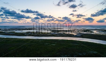 aerial drone view of sun setting on the Laguna Madre on Padre Island near Corpus Christi , Texas , USA with water ways and wetlands