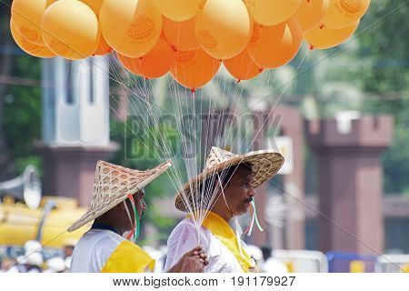 KOLKATA WEST BENGAL / INDIA - AUGUST 15TH 2016 : Colourful balloons are being carried by men with hat to celebrate India's Indepedence day. The day is celebrate all over India with huge enthusiasm and joy.