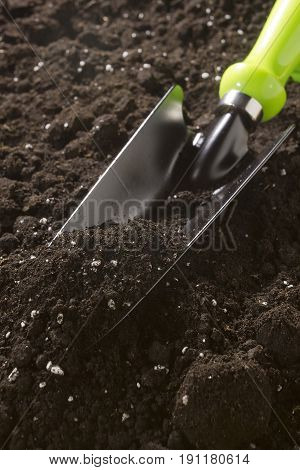 New garden tool in the soil close-up