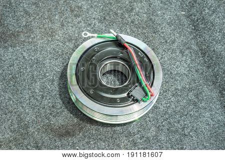 Car part and air conditioner system concept - Closeup new pulley of car air compressor system for replace new part service and copyspace