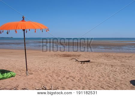 Sandy beach and orange umbrella at east point reserve Darwin 2017