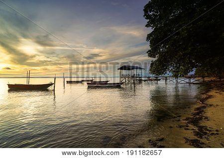 Labuan,Malaysia-May 21,2017:A peaceful beach with fisherman boats beautiful sunrise sky background in Labuan island,Malaysia.